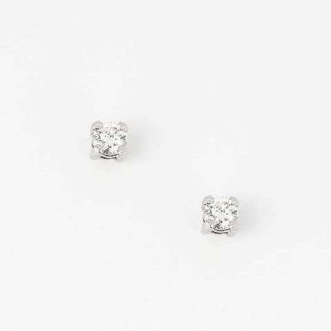 a beautiful pair of diamond stud earrings with twenty one points in total in white gold setting