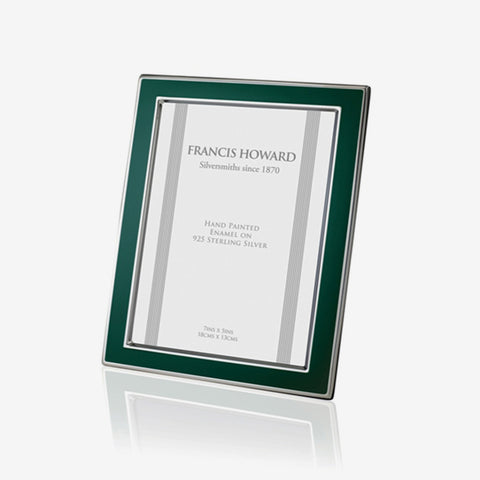 silver photo frame with green enamel edge and a wooden back english made