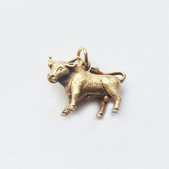 a vintage fine quality yellow gold bull charm