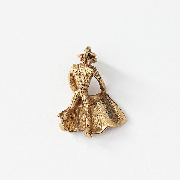 a gold bullfighter charm in yellow gold and a hallmark