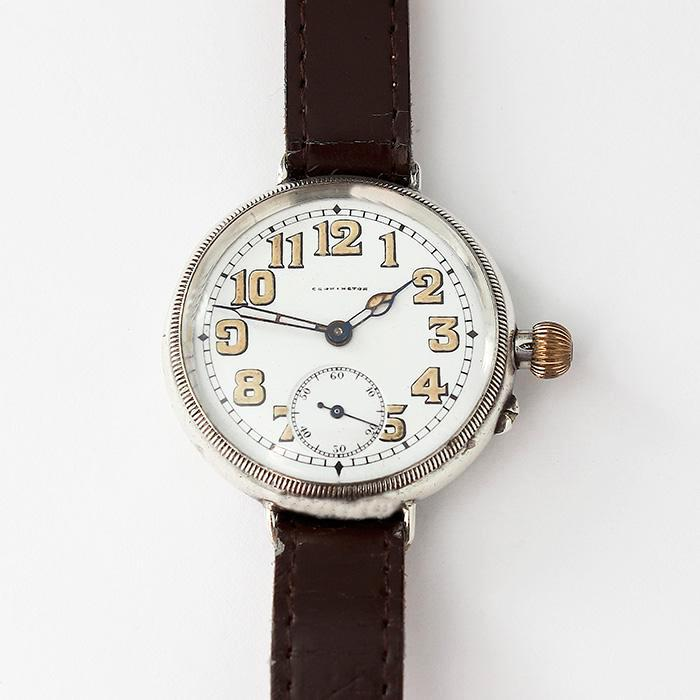 a vintage carrington gents watch with silver case dated 1926 and brown leather strap 12mm wide