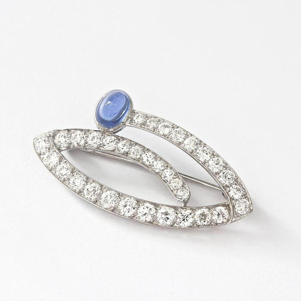 a secondhand old cut diamond and cabochon single sapphire brooch in 14 carat white gold