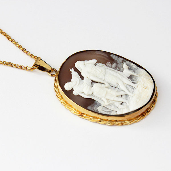 a vintage secondhand cameo pendant which is oval and large in size with a belcher chain