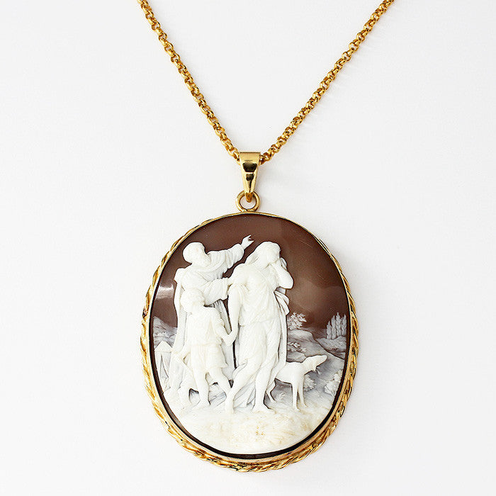 a secondhand large gold oval cameo pendant with 3 figures and a belcher necklace