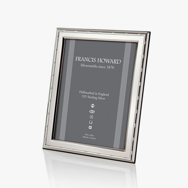 solid sterling silver photo frame with a ribbon design and wooden back with a box