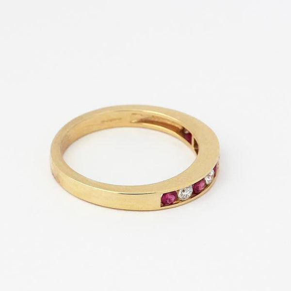 ruby and diamond half eternity ring in yellow gold with 5 rubies and 4 diamonds
