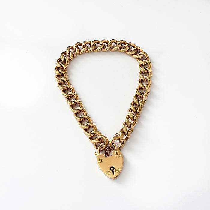 an antique yellow gold hollow charm bracelet with padlock and safety chain and part hallmarks probably 1898