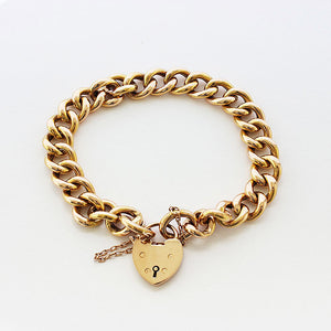 a beautiful secondhand 15 carat yellow gold charm bracelet and padlock
