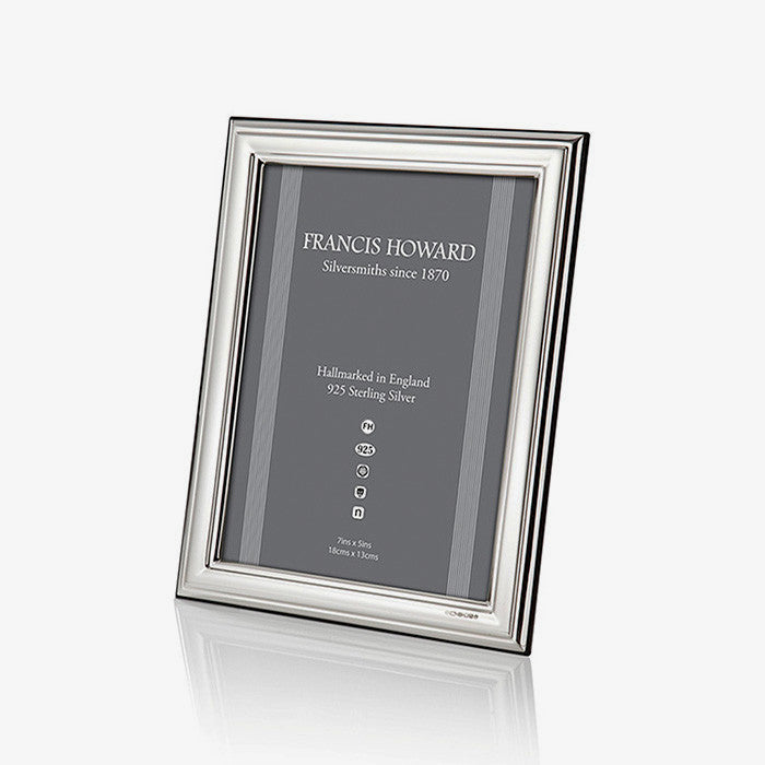silver photo frame with a plain ribbed edge and black wooden finish at the back english made