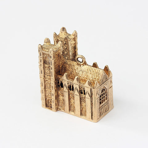 a large cathedral charm in yellow gold with 3d shape