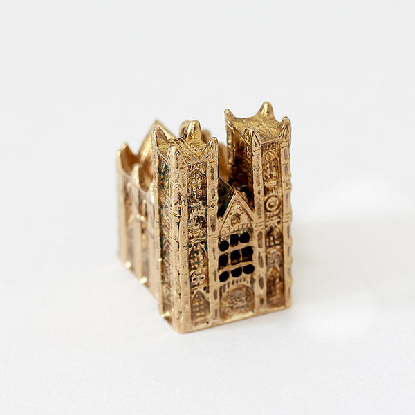 a secondhand vintage yellow gold cathedral charm large in size and solid