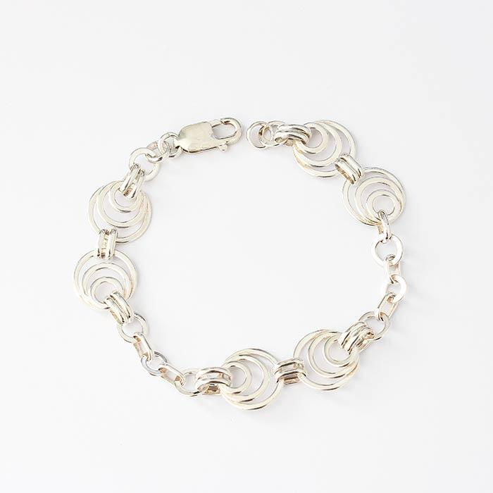 silver circle pattern link bracelet with smaller rings in between