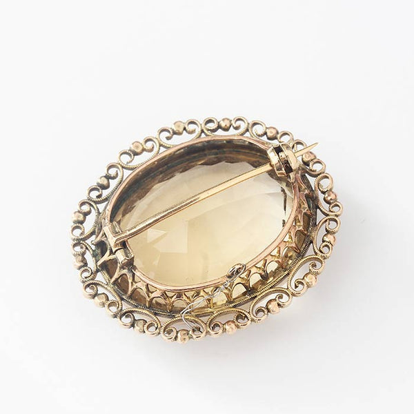 a pretty oval large citrine brooch in yellow gold