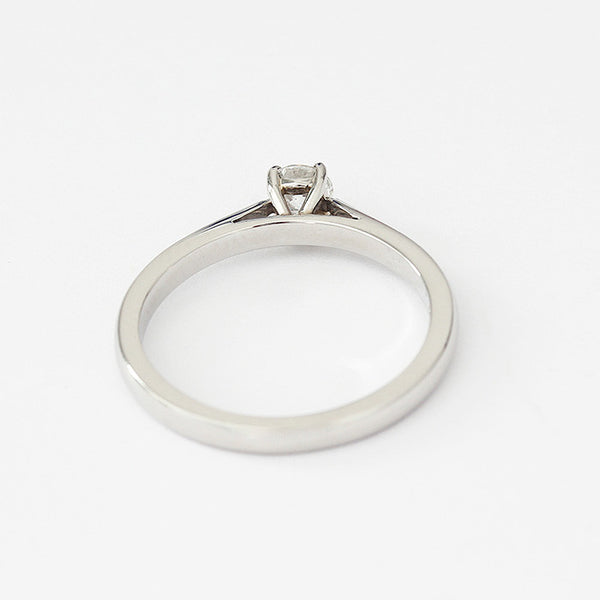 a platinum diamond ring with a claw setting and round stone