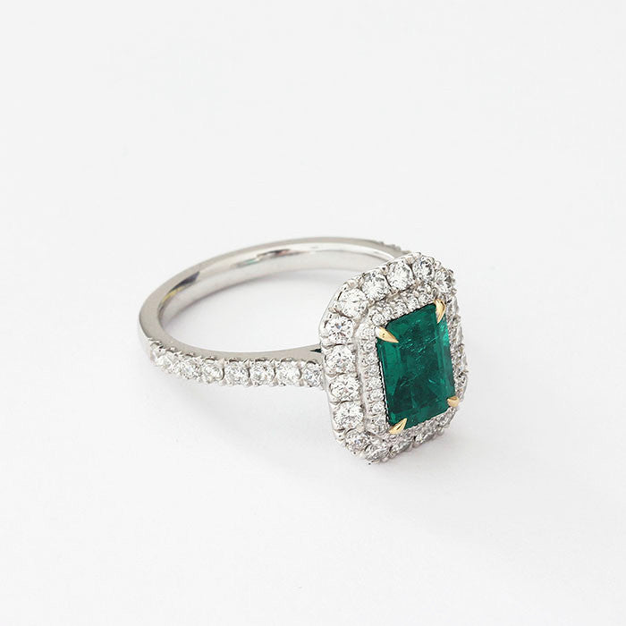 emerald and diamond modern cluster ring octagonal shape in platinum