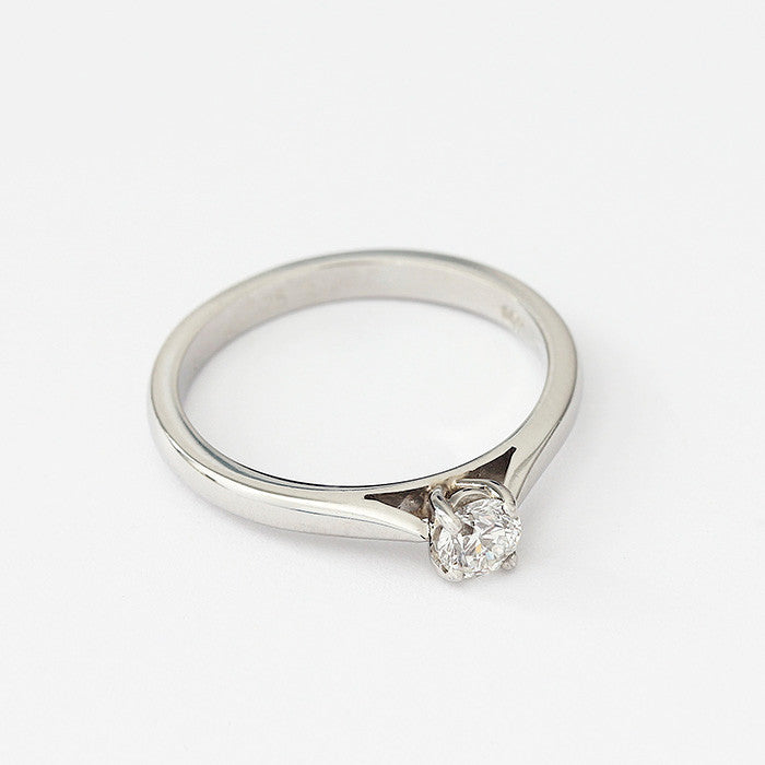 a classic diamond single stone engagement ring in platinum with 4 claw setting