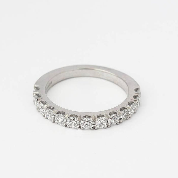 thirteen stone diamond set eternity ring with claw settings and made in platinum