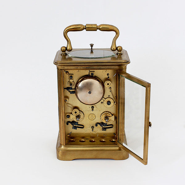 antique carriage clock with brass case and 8 day movement and white dial