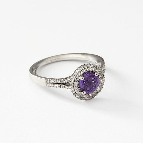 a purple sapphire and diamond cluster ring all set in platinum