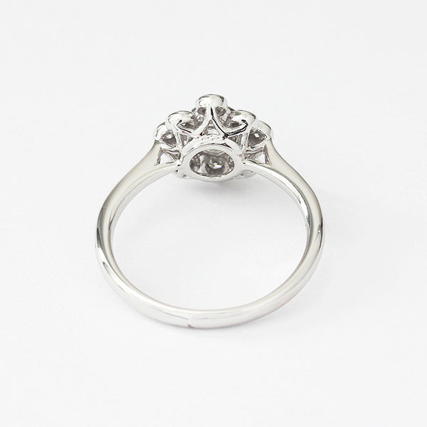 a modern diamond engagement ring in a cluster shape with rubover setting
