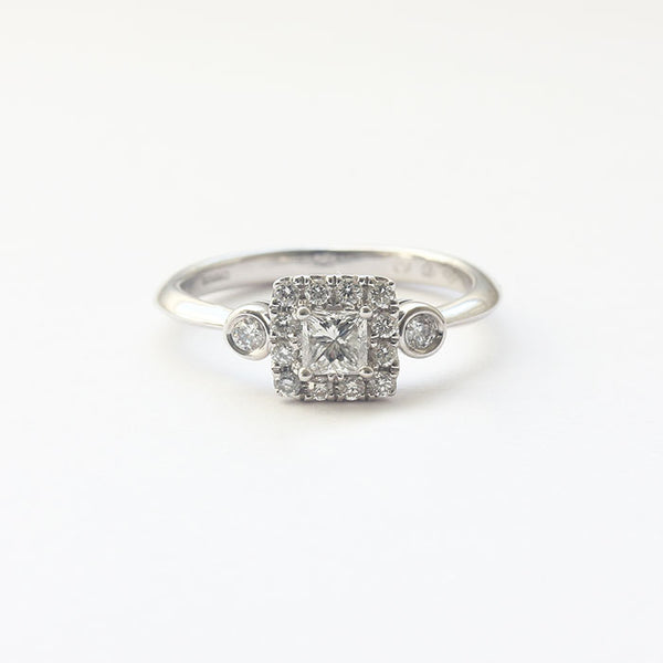 a white gold princess and brilliant cut diamond cluster ring