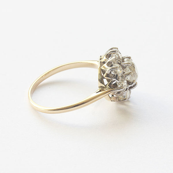 a secondhand diamond cluster ring in platinum and 18 carat yellow gold