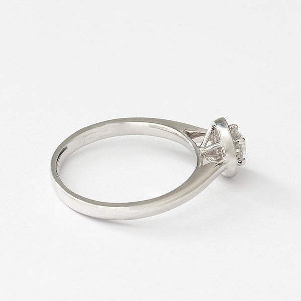 a diamond cluster ring in platinum with claw setting