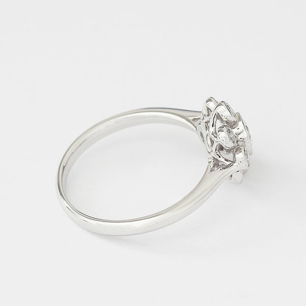 a contemporary floral shaped diamond cluster ring in 18ct white gold