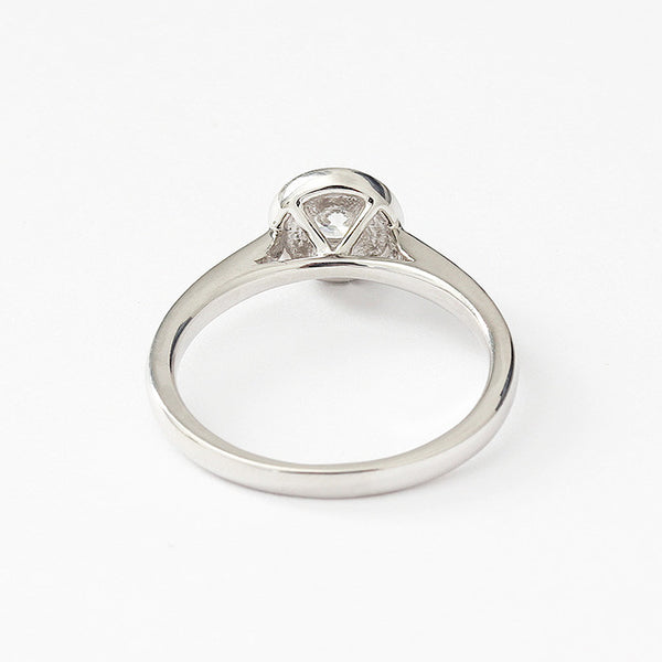 a diamond set cluster ring engagement style ring in platinum
