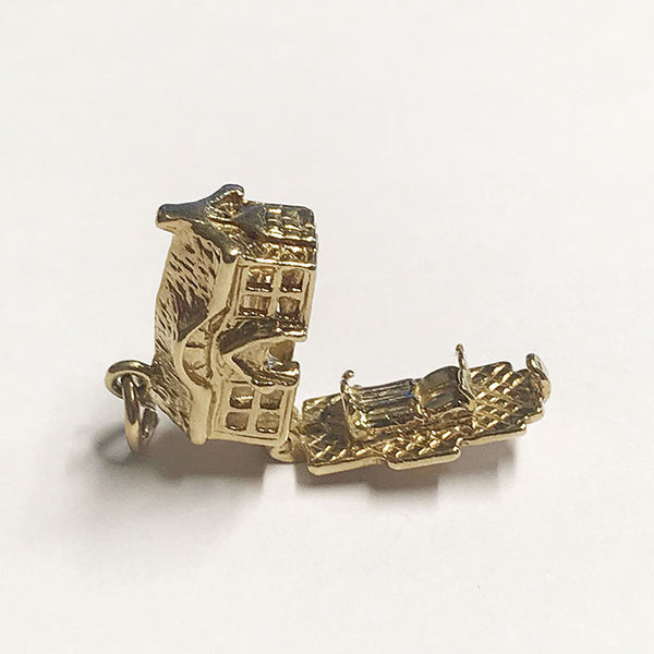an opening cottage gold charm vintage design with a double bed inside