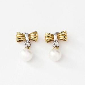 pearl and diamond gold drop earrings with bow design