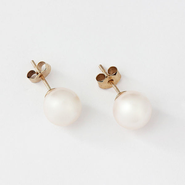 white pearl studs in yellow gold 8mm
