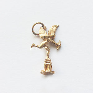 a yellow gold cupid eros charm vintage