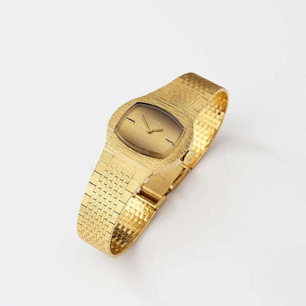 a CYMA ladies watch all made in 18 carat yellow gold case and bracelet with swiss hallmarks and manual movement