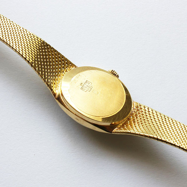 a vintage CYMA ladies 18 carat gold watch with mesh bracelet and full hallmark
