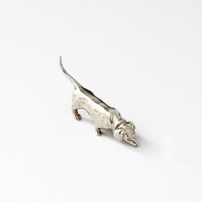 a sterling silver dachshund sniffing dog ornament model with full british hallmark and solid in weight