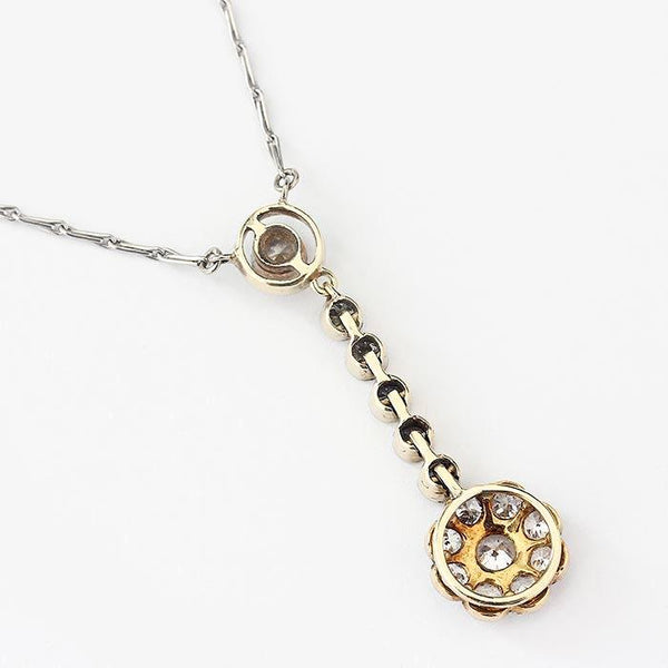 a secondhand diamond drop pendant with a platinum chain