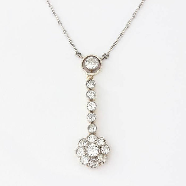a diamond drop pendant with daisy design and platinum necklace