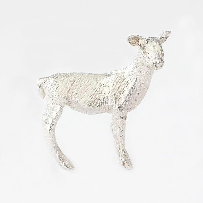 a silver small deer figure all solid in weight and british made