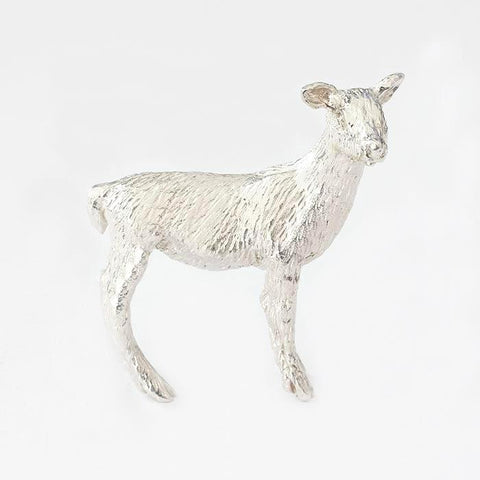 a silver small deer ornament all solid in weight and british made