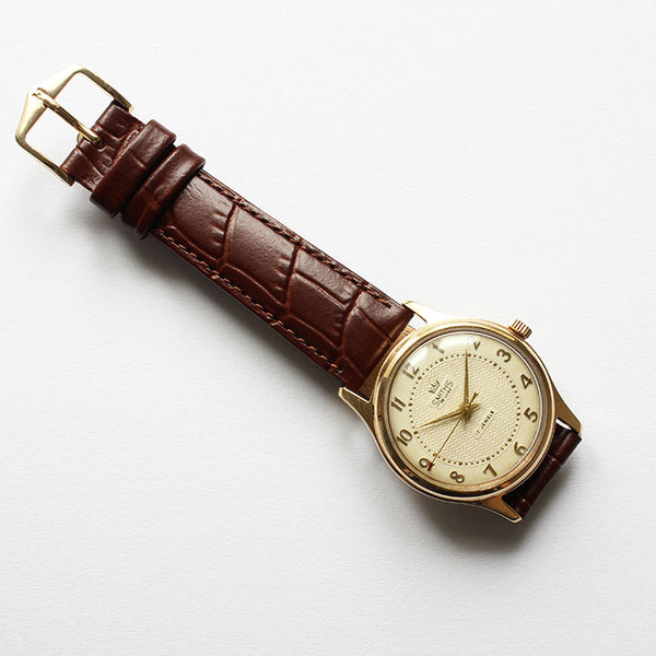 a fine quality smiths de luxe gold mens watch with brown leather strap