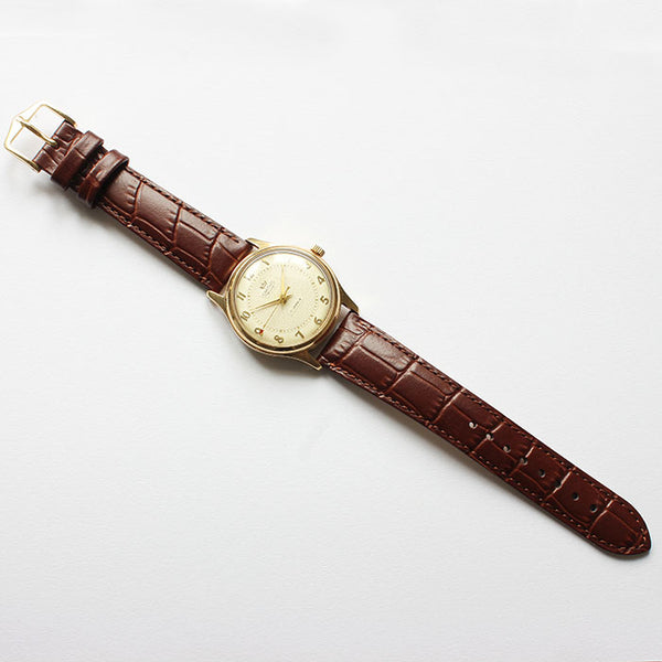 smiths vintage watch with brown leather strap and gold case dated 1958