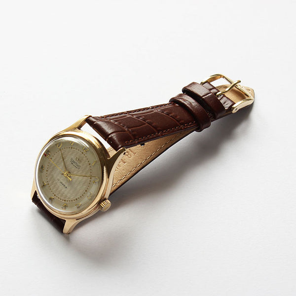 a superb smiths watch with gold case and brown leather strap and dated 1958 at marston barrett in lewes