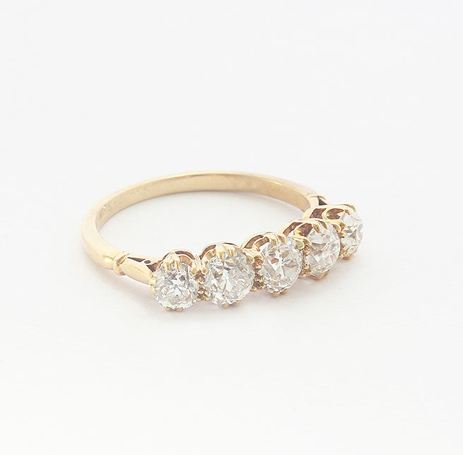 a beautiful secondhand five stone diamond ring in yellow gold