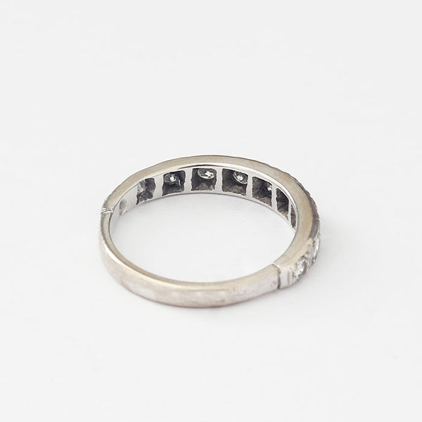 a diamond set three quarter eternity design ring with claw settings and mounted in platinum