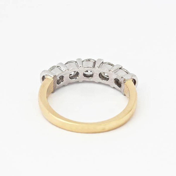 diamond set half eternity ring with 5 round stones and a white gold bar setting with yellow band