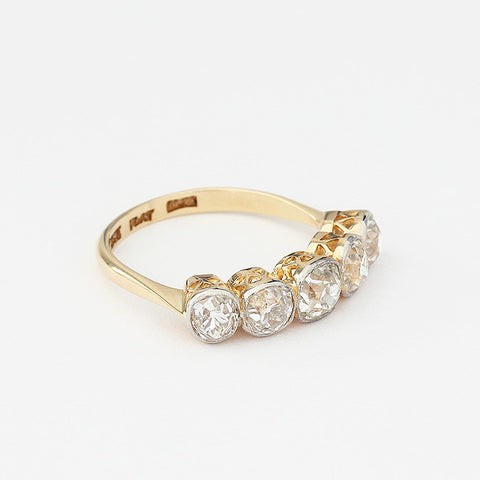 diamond 5 stone ring with rubover set yellow gold and platinum