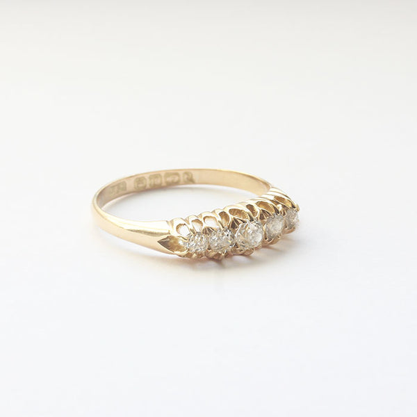 an antique diamond 5 stone old cut ring in yellow gold