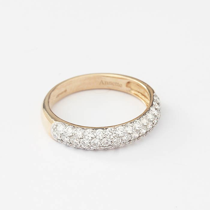 a three row round brilliant cut diamond set ring in yellow gold with annette engraved on the inside