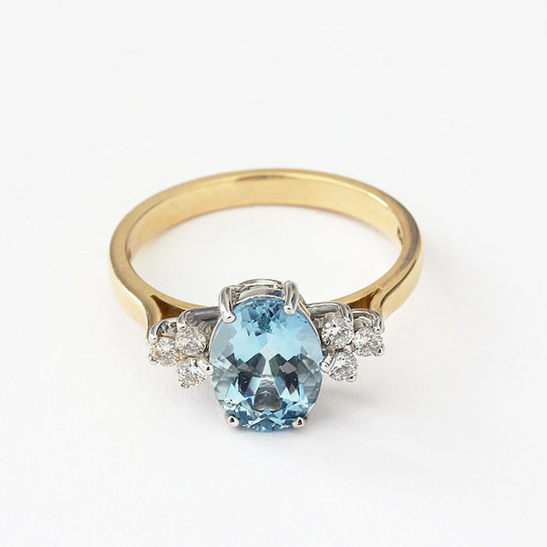 aquamarine and diamond ring in gold with a claw setting marston barrett lewes